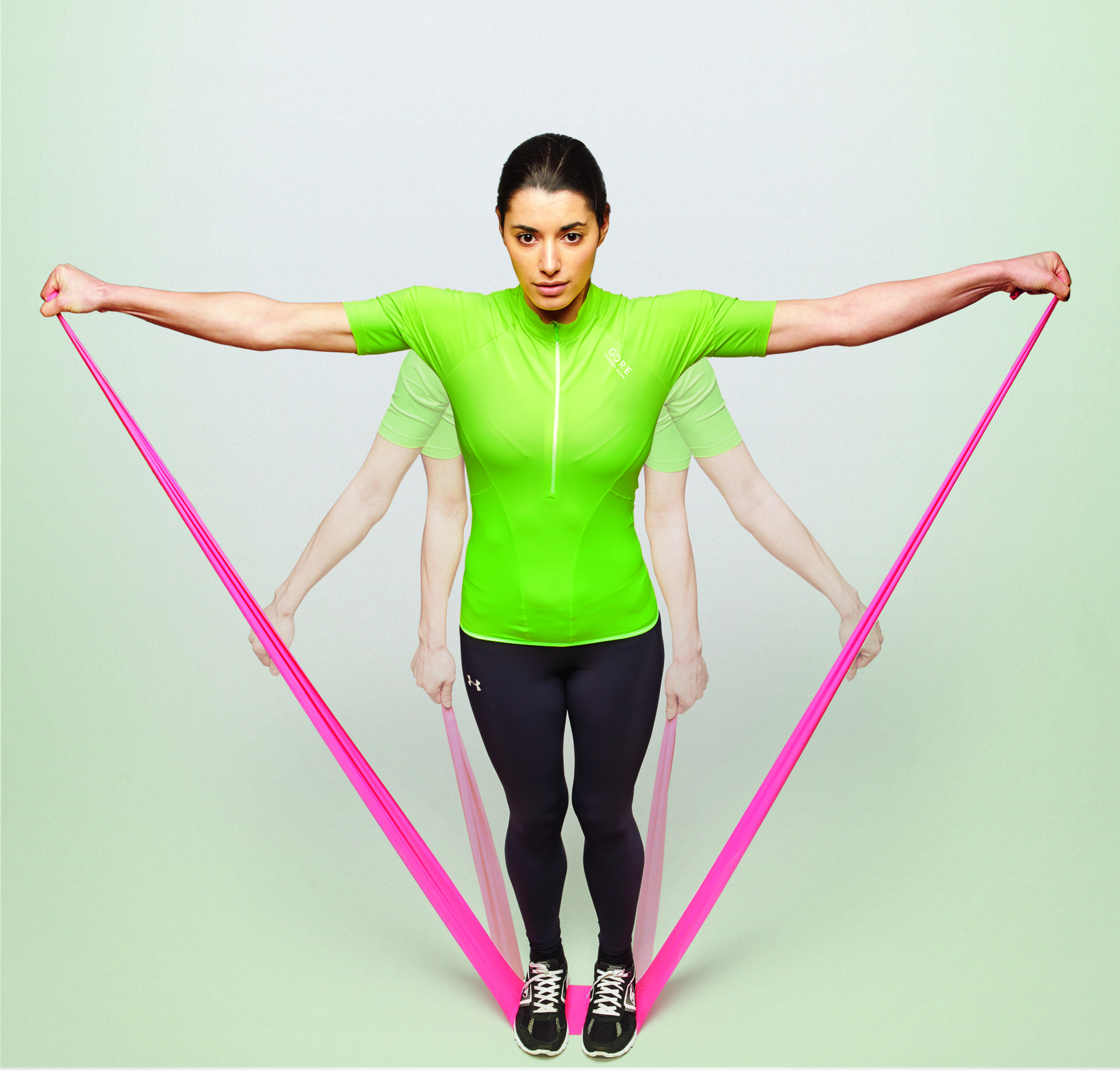 Women performing lateral raise with resistance band