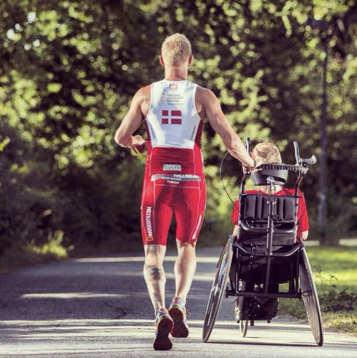 This man pushes, pulls and carries his disabled twin around ironmans and marathons
