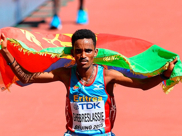 Ghirmay Ghebreslassie of Eritrea celebrates winning the Men's Marathon during the IAAF World Athletics Championships 2015. Photo: Getty Images