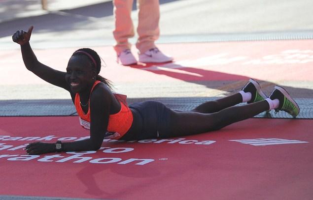 Florence Kiplagat of Kenya celebrates winning the Women's 2015 Chicago Marathon. Photo: Getty Images.