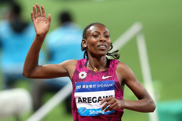 Aregawi celebrates at the 2014 1500m Diamond League in Shanghai. Photo credit: Getty Images