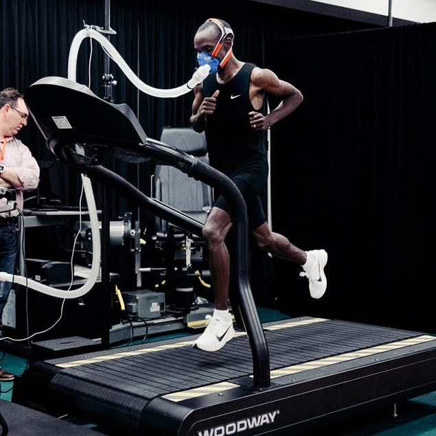 Kipchoge, along with the other runners, did treadmill tests at Nike headquarters earlier this month. The mask he's wearing allows researchers to measure how much oxygen and carbon dioxide he's inhaling and exhaling, enabling them to calculate his maximal aerobic capacity (VO2 max) and how much energy he burns at different running paces. Photography by Nike/Clayton Cotterell