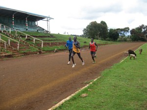 Doris Jerop being paced by coach David Kemboi