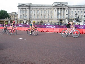Athletes sweep past Buckingham Palace on the spectacular seven-lap bike course.